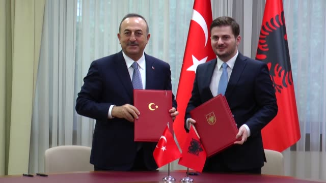 turkish foreign minister mevlut cavusoglu and albanian acting foreign minister gent cakaj attend a signing ceremony of bilateral agreements between... - tirana stock videos & royalty-free footage