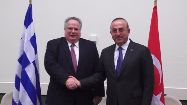 Turkish Foreign Minister Mevlut Cavusoglu and Greek Foreign Minister Nikos Kotzias hold a bilateral meeting on the sidelines of the NATO Foreign...