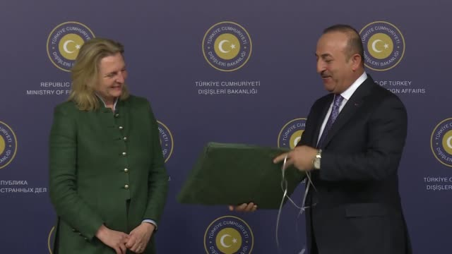 turkish foreign minister mevlut cavusoglu and his austrian counterpart karin kneissl exchange gifts during their meeting at dolmabahce prime ministry... - traditionally austrian stock videos & royalty-free footage