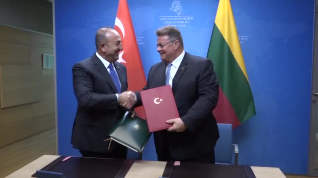 Turkish Foreign Minister Mevlut Cavusoglu and his Lithuanian counterpart Linas Linkevicius attend a signing ceremony of a bilateral agreement between...