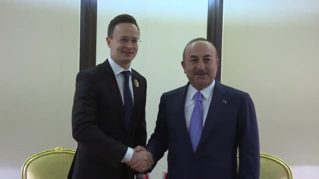 turkish foreign minister mevlut cavusoglu and hungarian minister of foreign affairs and trade peter szijjarto hold a bilateral meeting on the... - osteuropäische kultur stock-videos und b-roll-filmmaterial