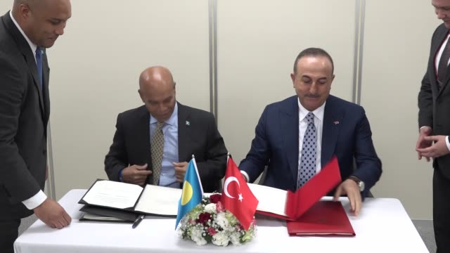 turkish foreign minister mevlut cavusoglu and minister of public infrastructure industries and commerce of palau charles obichang sign air transport... - micronesia stock videos & royalty-free footage