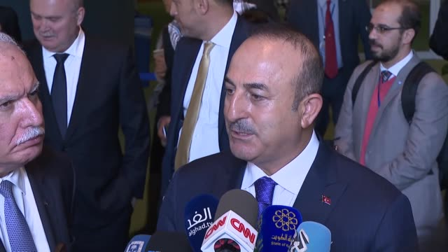 Turkish Foreign Minister Mevlut Cavusoglu and Palestinian Foreign Minister Riyad alMaliki speak to reporters following the voting on Jerusalem at an...