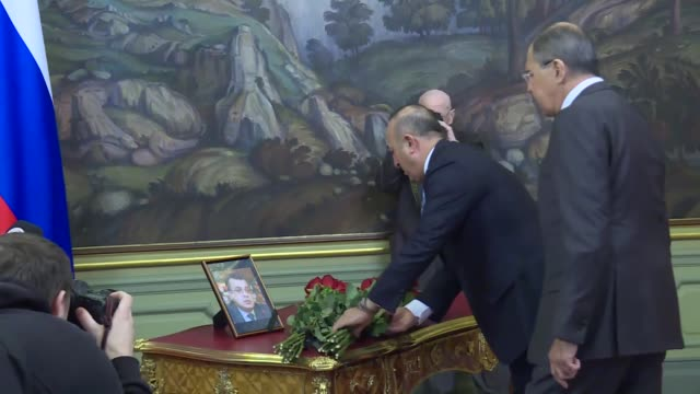turkish foreign minister mevlut cavusoglu and russian foreign minister sergei lavrov lay flowers near a portrait of russian ambassador to turkey... - assassination of andrei karlov stock videos & royalty-free footage