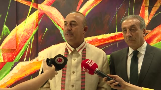 turkish foreign minister mevlut cavusoglu and vice chairman of the justice and development party , mehdi eker speak to the press after a gala dinner... - association of southeast asian nations stock videos & royalty-free footage