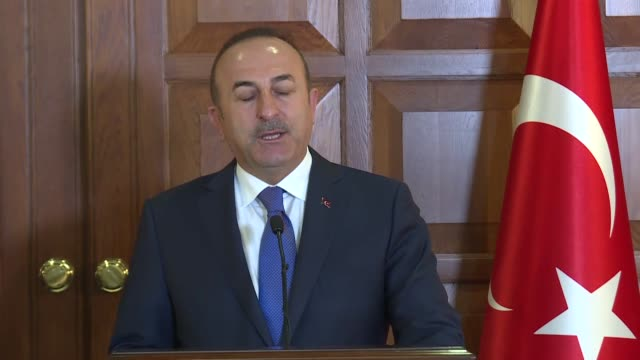 Turkish Foreign Minister Mevlut Cavusoglu answers journalists' questions during a joint press conference with his Maltese counterpart Hon Carmelo...