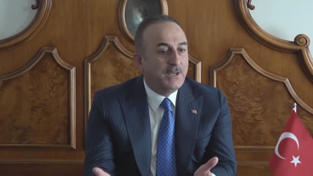 vídeos de stock e filmes b-roll de turkish foreign minister mevlut cavusoglu answers journalists' questions on the sidelines of the 5th edition of the mediterranean dialogues... - eastern european culture