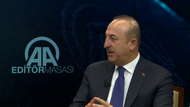Turkish Foreign Minister Mevlut Cavusoglu answers the journalists' questions at Anadolu Agency Editors' Desk in Ankara Turkey on January 10 2018...
