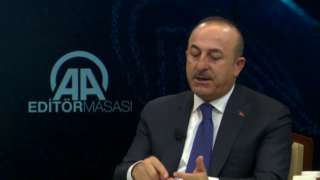Turkish Foreign Minister Mevlut Cavusoglu answers the journalists' questions at Anadolu Agency Editors' Desk in Ankara Turkey on January 10 2018 The...