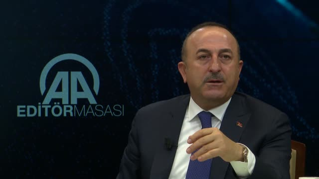 Turkish Foreign Minister Mevlut Cavusoglu answers the journalists' questions at Anadolu Agency Editors' Desk in Ankara Turkey on January 10 2018 On...