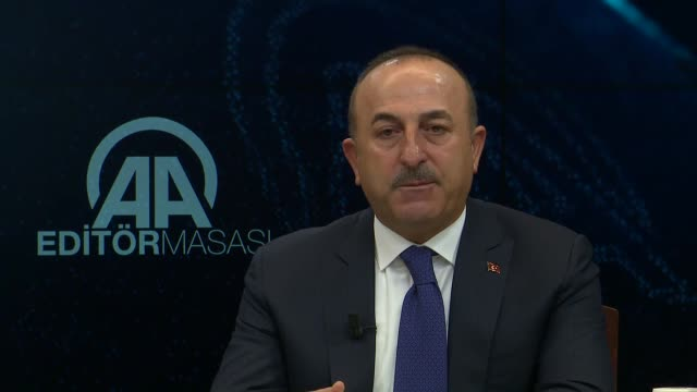 Turkish Foreign Minister Mevlut Cavusoglu answers the journalists' questions at Anadolu Agency Editors' Desk in Ankara Turkey on January 10 2018 If...