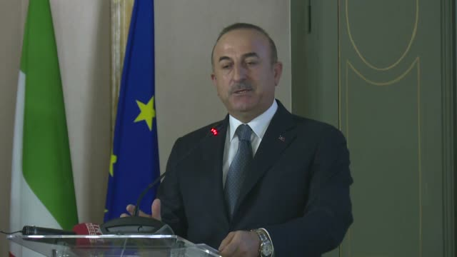 Turkish Foreign Minister Mevlut Cavusoglu delivers a speech at 10th TurkishItalian Forum alongside his Italian counterpart Angelino Alfano on...