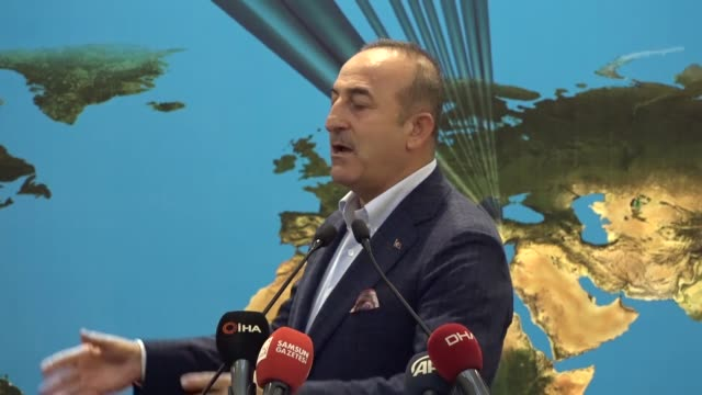 turkish foreign minister mevlut cavusoglu delivers a speech at a lunch gathering with businessmen, members of some ngos and students in northern... - 外交点の映像素材/bロール