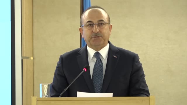 vídeos de stock e filmes b-roll de turkish foreign minister mevlut cavusoglu gives a speech at the high level segment of the 40th session of the united nations human rights council on... - cargo governamental
