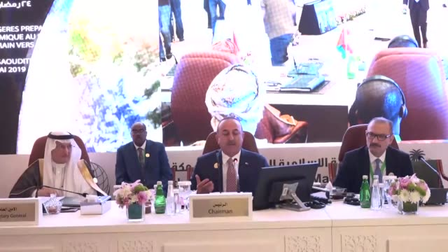 turkish foreign minister mevlut cavusoglu gives a speech next to secretary general of the organization of islamic cooperation yousef al-othaimeen... - jiddah stock-videos und b-roll-filmmaterial