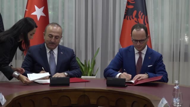 turkish foreign minister mevlut cavusoglu his albanian counterpart ditmir bushati and their accompanying delegations hold a meeting in tirana albania... - tirana stock videos & royalty-free footage