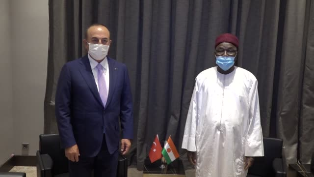 turkish foreign minister mevlut cavusoglu is welcomed by nigerian foreign minister kalla ankourao upon his arrival in niamey, niger on july 20, 2020. - ニアメ点の映像素材/bロール