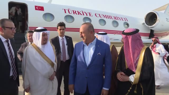 Turkish Foreign Minister Mevlut Cavusoglu is welcomed by Saudi Minister of State for Foreign Affairs Nizar Bin Obaid Madani upon his arrival at King...
