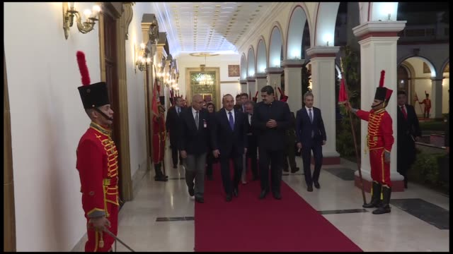 turkish foreign minister mevlut cavusoglu is welcomed by venezuelan president nicolas maduro ahead of their meeting in caracas venezuela on september... - maduro stock videos & royalty-free footage