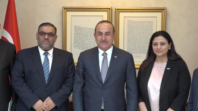 turkish foreign minister mevlut cavusoglu meets with anas alabde the head of the national coalition for syrian revolutionary and opposition forces... - foreign minister stock videos and b-roll footage