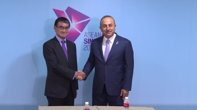 turkish foreign minister mevlut cavusoglu meets with his japanese counterpart taro kono on the sidelines of the 51th asean foreign ministers' meeting... - association of southeast asian nations stock videos & royalty-free footage