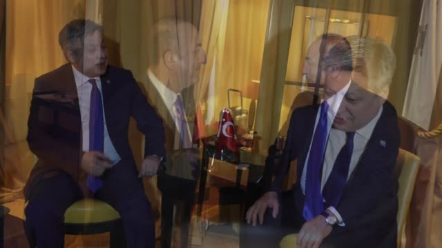Turkish Foreign Minister Mevlut Cavusoglu meets with his Kyrgyz counterpart Erlan Abdyldayev on the sidelines of 2018 Munich Security Conference at...