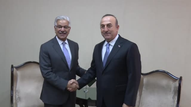 Turkish Foreign Minister Mevlut Cavusoglu meets with his Pakistani counterpart Khawaja Muhammad Asif ahead of a trilateral meeting of the ministers...