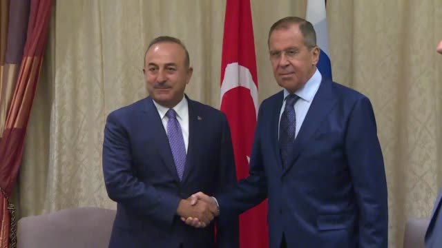 turkish foreign minister mevlut cavusoglu meets with his russian counterpart sergei lavrov on the sidelines of the association of southeast asian... - association of southeast asian nations stock videos & royalty-free footage