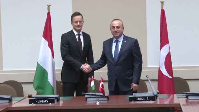 turkish foreign minister mevlut cavusoglu meets with hungarian foreign affairs and trade minister peter szijjarto on the sidelines of the nato... - eastern european culture stock videos & royalty-free footage