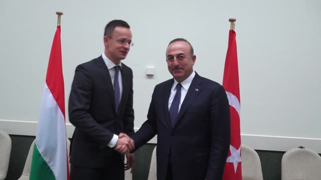 Turkish Foreign Minister Mevlut Cavusoglu meets with Hungarian Minister of Foreign Affairs and Trade Peter Szijjarto on the sidelines of the NATO...