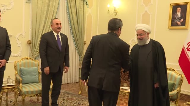 turkish foreign minister mevlut cavusoglu meets with iranian president hassan rouhani in tehran iran on february 07 2018 the official visit comes... - minister president stock videos and b-roll footage