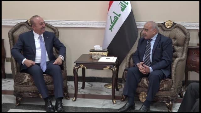 turkish foreign minister mevlut cavusoglu meets with iraq's prime minister-designate, adel abdul mahdi in baghdad on october 11, 2018. - prime minister bildbanksvideor och videomaterial från bakom kulisserna