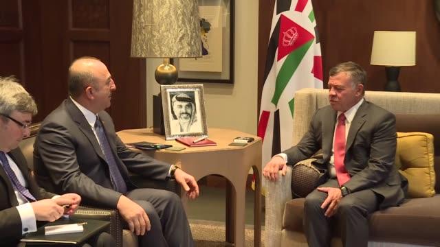 Turkish Foreign Minister Mevlut Cavusoglu meets with King Abdullah II of Jordan on February 19 2018 in Amman Jordan