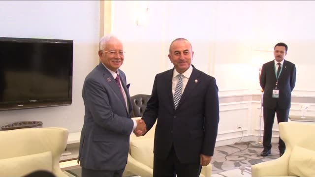 turkish foreign minister mevlut cavusoglu meets with malaysian prime minister najib razak within the 48th association of southeast asian nations... - association of southeast asian nations stock videos & royalty-free footage
