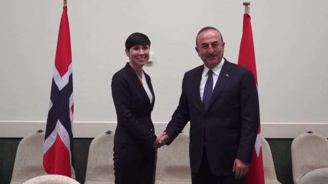 Turkish Foreign Minister Mevlut Cavusoglu meets with Norwegian Foreign Minister Ine Marie Eriksen Soreide on the sidelines of the NATO Foreign...