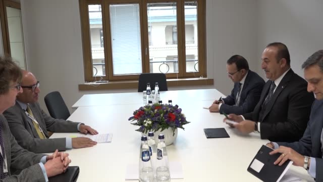 vidéos et rushes de turkish foreign minister mevlut cavusoglu meets with president of the european bank for reconstruction and development suma chakrabarti in brussels,... - président