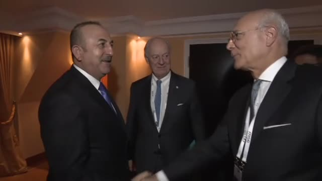 Turkish Foreign Minister Mevlut Cavusoglu meets with United Nations and Arab League Envoy to Syria Staffan de Mistura in Munich Germany on February...