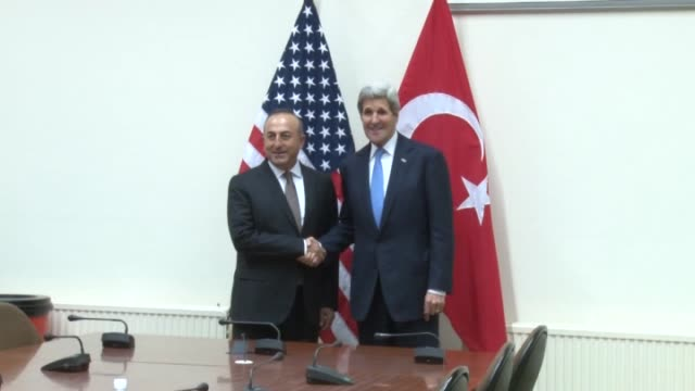 Turkish Foreign Minister Mevlut Cavusoglu meets with US Secretary of State John Kerry within the NATO Foreign Ministers meeting in Brussels Belgium...