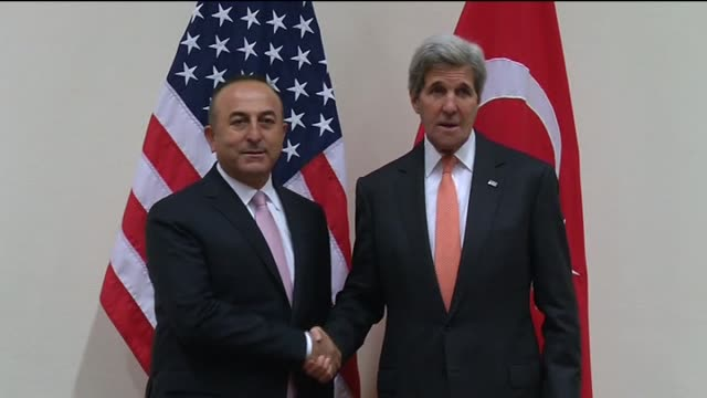 Turkish Foreign Minister Mevlut Cavusoglu meets with US Secretary of State John Kerry on the sidelines of the meetings of NATO Ministers of Foreign...