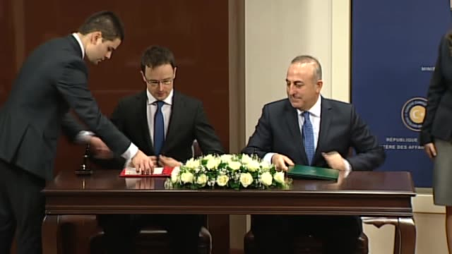 turkish foreign minister mevlut cavusoglu signs a cooperation protocol with hungarian foreign minister peter szijjarto and they hold a joint press... - ungarische kultur stock-videos und b-roll-filmmaterial