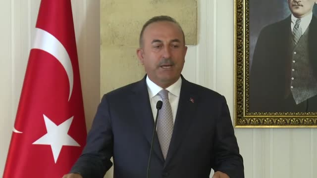 turkish foreign minister mevlut cavusoglu speaks at a joint press conference withturkish cypriot president mustafa akinci following their meeting in... - 後を追う点の映像素材/bロール