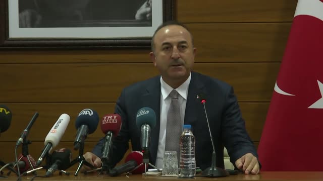 Turkish Foreign Minister Mevlut Cavusoglu speaks at a joint press conference with his Palestinian counterpart Riyad alMaliki at Ataturk airport in...