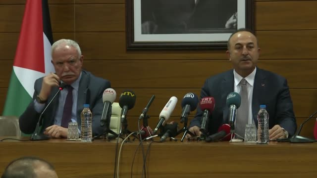 Turkish Foreign Minister Mevlut Cavusoglu speaks at a joint press conference with his Palestinian counterpart Riyad alMaliki before flying to New...