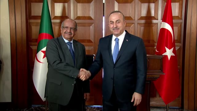 Turkish Foreign Minister Mevlut Cavusoglu speaks at a joint press conference with his Algerian counterpart Abdelkader Messahel following their...