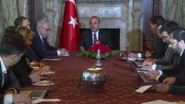 Turkish Foreign Minister Mevlut Cavusoglu speaks at the residence of Turkey's Ambassador to the US Serdar Kilic in Washington USA on June 04 2018 A...