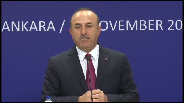 Turkish Foreign Minister Mevlut Cavusoglu speaks during a joint press conference with EU foreign policy chief Federica Mogherini and EU Neighborhood...