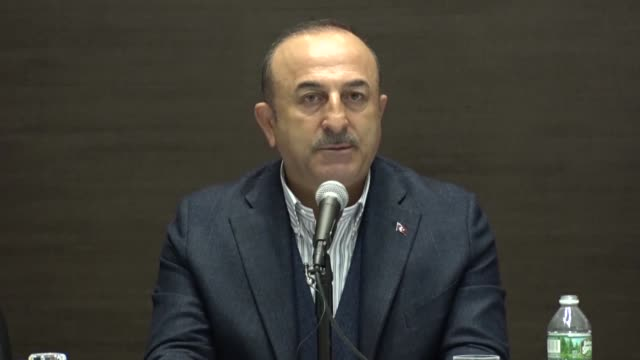 Turkish Foreign Minister Mevlut Cavusoglu speaks during his meeting with Turkish citizens at Ankara's New York consulate on November 17 2018 Turkish...