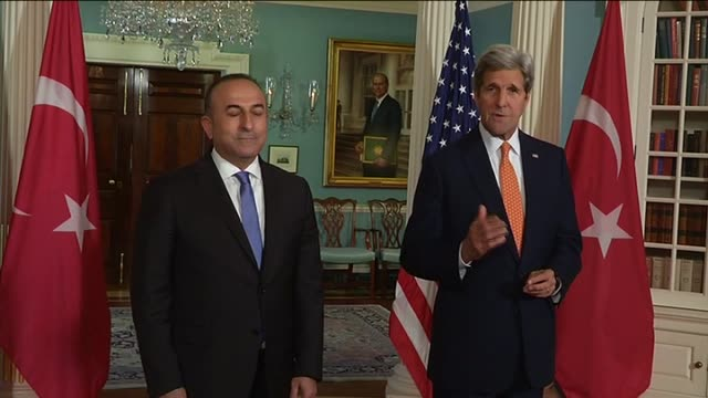 Turkish Foreign Minister Mevlut Cavusoglu speaks to press alongside US Secretary of State John Kerry at the State Department before he attends the...