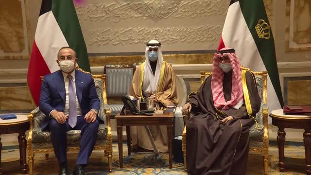 turkish foreign minister mevlutcavusoglu meets with kuwaiti emir sheikh nawaf al-ahmad al-jaber al-sabah on february 09, 2021 in kuwait city, kuwait. - シャイフ点の映像素材/bロール