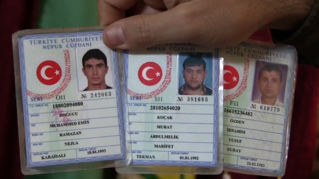turkish identity cards of fighters of islamic state of iraq and the levant isis or daesh captured by kurdish people's protection unit ypg in syrian... - eddie gerald stock videos & royalty-free footage